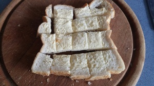 butter the bread and cut into bite sized pieces