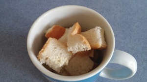 place bread into a large mug.