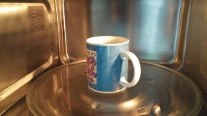 place mug in microwave.